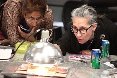 Teachers build and test affordable hands-on lesson plans at a Teacher Liaison workshop at the Space Foundation Discovery Center.