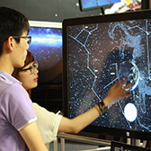 visitors explore NUIverse display