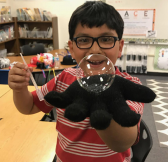 Boy holding large bubble